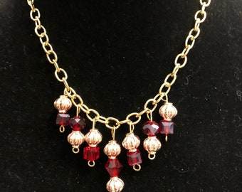 Gold and Red beaded cluster necklace. Perfect for Prom