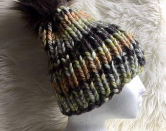 Unique winnter knit hat with faux fur pom