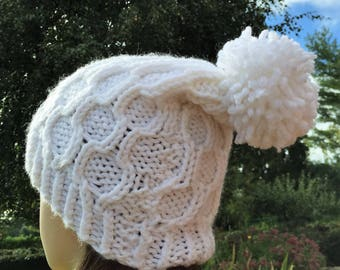 Adult winter hat with big hand knitted Pompom