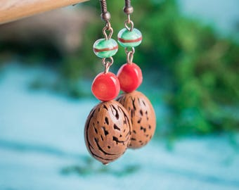 Boho chic earrings_red green brown_artisan lampwork glass_organic eco-friendly_teardrop_natural coral nut_tribal gypsy Strega_Aries Scorpio