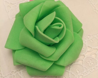 18  3 inch foam flowers  green and orange