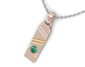 Hoverboard Pendant set with a Green Emerald