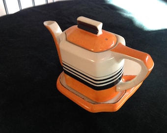 Vintage japanese teapot with stand, orange with black and cream stripes