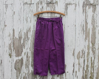 1980s purple capri beach pants by Hang Ten, made in USA, 50/50 cotton polyester, two front pockets, elastic waistband, medium, side slits