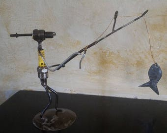 Candle and recycled parts - fisherman sculpture
