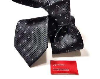 Cravatta in seta con puntini neri di argento e antracite