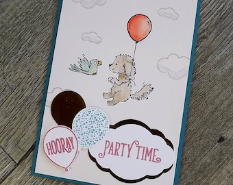 Child's birthday card with flying dog, bird, and balloons
