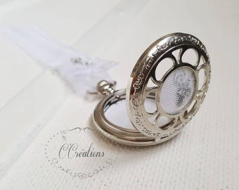 Silver watch, wedding ring, white linen, silver lace and organza