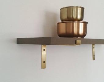 brass brackets book shelf design sponge designsponge black