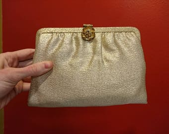 Little Gold Clutch Purse (A 50s era tiny metallic clutch with flower clasp.] 8 inch by 6 inch