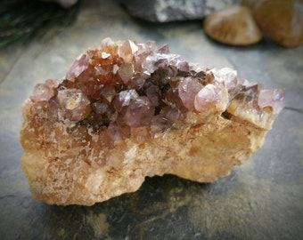 Amethyst ametrine crystal cluster in matrix