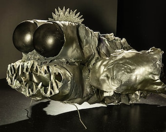 Creature from the depths .  Recycled materials.