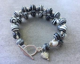 Black and white swirly beaded charm bracelet with heart charm. Statement bracelet bold heart gift for her career bracelet