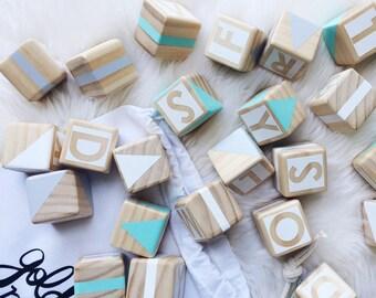 Wooden alphabet blocks - green, grey + white