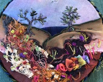 """Sunset fantasy hillside fiber art 3""""pin or mini landscape."""