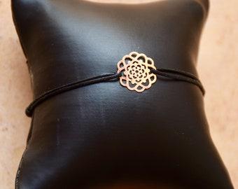 Cotton bracelet with silver charm