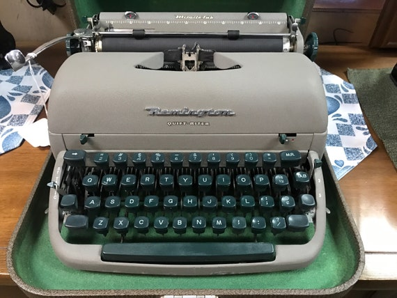 Remington portable typewriter with green keys