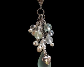Necklace with sea glass, glass beads and freshwater pearls and a charm