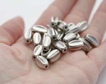 Silver Acrylic Beveled Pinched Oval Beads 12mm (30)