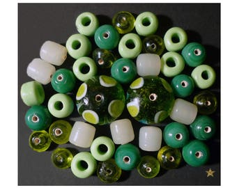 Handmade Indian green of various shapes, white glass beads