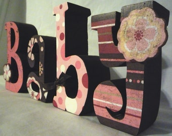 Cute brown and pink BABY letters with flowers