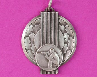 French vintage shooting or hunting medal in an Art Deco or Bauhaus style.