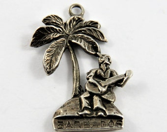 Barbados Man Sitting Under Palm Tree Playing His Guitar Sterling Silver Charm of Pendant.