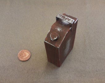 One sixth, or play scale, miniature model of a small rectangular fuel can.