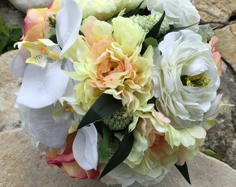 White ranunculus, orchid, rose and dalia bouquet with matching boutonnière