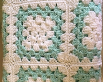 Blue and white granny square baby blanket