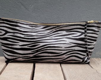 Womens leather clutch made by calf hair leather
