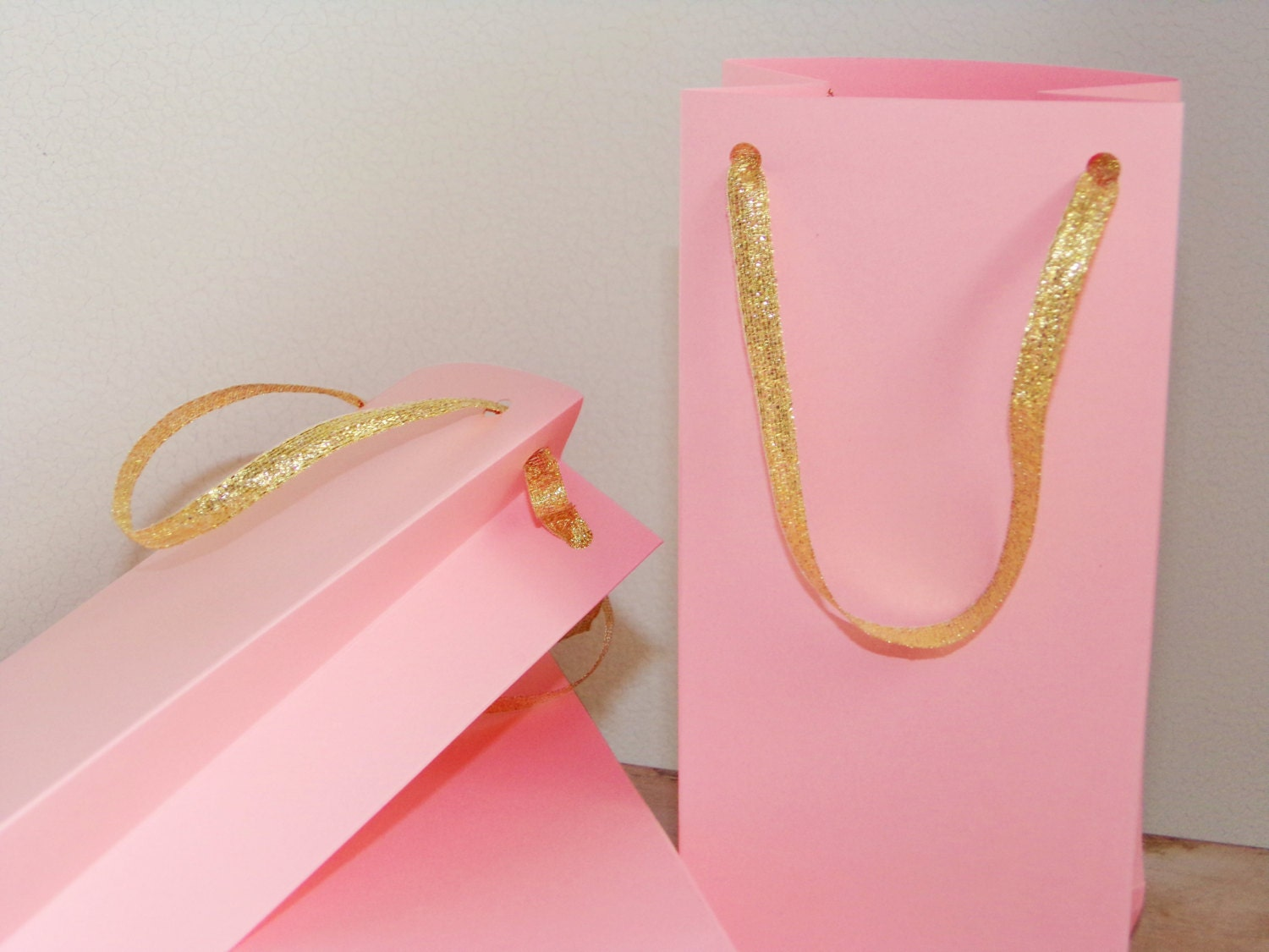 Pink and gold paper bags