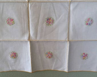 Stuning Table cloth Ivory with a cluster of flowers in each square.