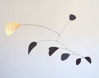 Abstract  Black and Brass Metal Mobile.