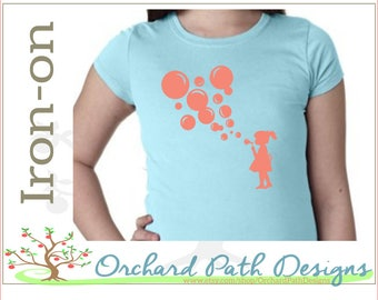 Little Girl Blowing Bubbles iron on decal for clothing, canvas bags, pilows, aprons, other fabric items
