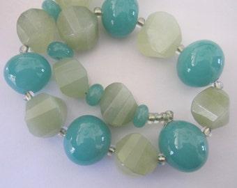 CELADON HOLLOWS & JADE - 11 Handmade Lampwork Glass Beads