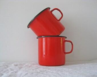 Red mugs, pair of French enamel mugs