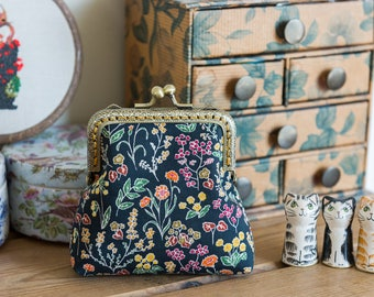 Coin purse made with Liberty Tana Lawn in the print: 'Tess and Rosa', a golden cotton lining, and hand stitched bronze coloured metal frame