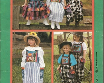 k. p. kid's & co Pattern: Wild West Jumpers (Dresses) and Overalls. Girls' sizes 2, 3, 4, 5, 6, 6x. UNCUT