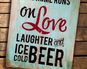 "This Home Runs on Love, Laughter and Ice Cold Beer...wooden sign measures 18"" x 22"""