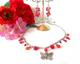 Set of butterflies and beads in shades of orange, red and fuchsia