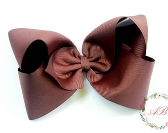 4 inch brown boutique style bow on matching ribbon lined alligator clip