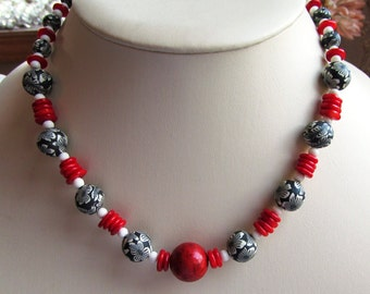Graduated 19 Inch Necklace of Red Coral Discs, Fimo Clay Animal Print and Bone Beads