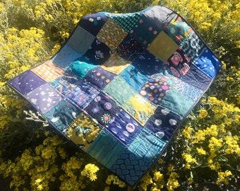 Blue patchwork lap quilt
