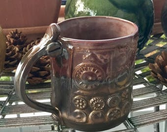 Large cup of ceramics with steampunk ornaments