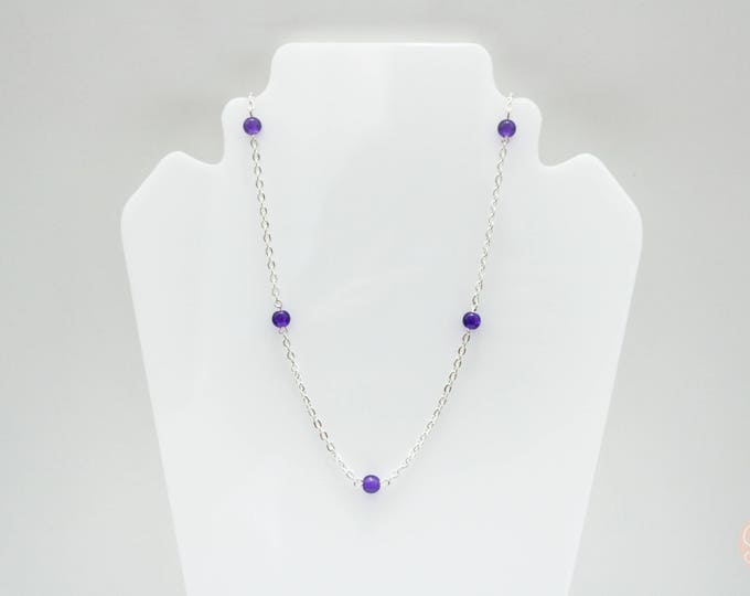 Purple and Silver long beaded necklace.