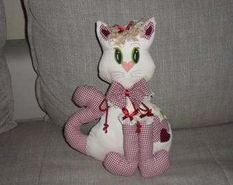 decorative cat can be used as a doorstop