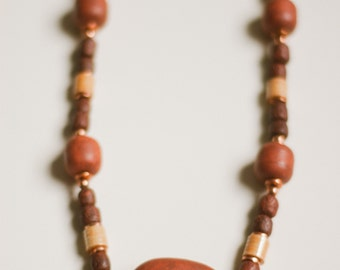 Vintage 1970s chunky stone bead necklace, natural raw red brown stone beads + gold, heavy primative tribal beaded layering necklace pendant