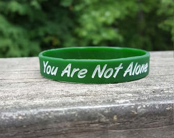 You Are Not Alone Wristband's - Hunter Green