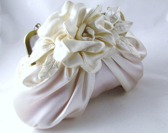 Ivory bridal satin clutch with pleats and flower detail  - Gardenia